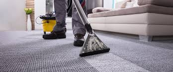 Close up of a hoover cleaning a very dirty carpet.